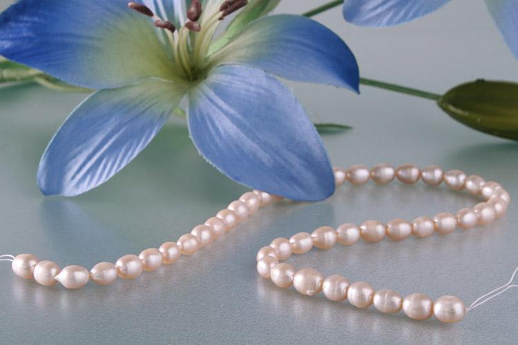 E120 Echter Süßwasser-Perlen-Strang irregular 5-6mm 38cm lang offen pastellorang