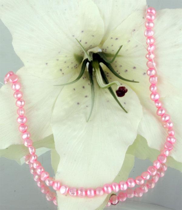 Perlenstrang pink ca. 38cm irregular