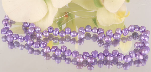 Perlenstrang irregular 5-6mm violett S101